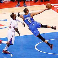 11 May 2014: Oklahoma City Thunder guard Russell Westbrook (0) goes to the hoop past Los Angeles Clippers guard Chris Paul (3) during the Los Angeles Clippers 101-99 victory over the Oklahoma City Thunder, during Game Four of the Western Conference Semifinals of the NBA Playoffs, at the Staples Center, Los Angeles, California, USA.