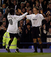 Fotball<br /> England 2004/2005<br /> Foto: SBI/Digitalsport<br /> NORWAY ONLY<br /> <br /> Everton v Bolton Wanderers<br /> Barclays Premiership, 04/12/2004.<br /> <br /> Bolton's Kevin Davies (R) celebrates his second goal with Jay Jay Okocha