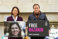 © Licensed to London News Pictures. 26/10/2021. LONDON, UK. (L) Catherine West MP, Shadow Secretary of Europe and the Americas, with Richard Ratcliffe, husband of detained British-Iranian aid worker Nazanin Zaghari-Ratcliffe, on day 3 of his hunger strike outside the Foreign and Commonwealth Office demanding that the UK government tries to do more to secure her release.  Mrs Zaghari-Ratcliffe has been held in Iran since 2016 and has not seen her daughter for two years and faces a return to prison.  Photo credit: Stephen Chung/LNP