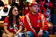 SAN FRANCISCO, CA - FEBRUARY 02: Priscilla Ostergar (L) and her husband Paul Ostergar of West Sacramento, California react during a Super Bowl LIV watch party after the Kansas City Chiefs defeat the San Francisco 49ers, at SPIN San Francisco on February 2, 2020 in San Francisco, California. The San Francisco 49ers faced the Kansas City Chiefs in Super Bowl LIV for their seventh appearance at the NFL championship, leading the game into half time and losing after 21 unanswered points in the second half of the game. (Photo by Philip Pacheco/Getty Images)