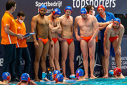 Time out Coach Harry van der Meer, Bilal Gbadamassi, Thomas Lucas, Robin Lindhout of the Netherlands against Croatia during the Olympic qualifying tournament. The Dutch water polo players are on the hunt for a starting ticket for the Olympic Games on February 15, 2021 in Rotterdam