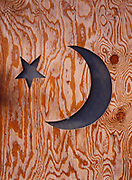 Details of plywood outhouse with nicely cut crescent moon and star near Livengood, Alaska.