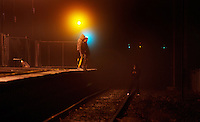 Railway Stations at night. Altona Railway Train Station. About 9:00pm, three youths are throwing and retrieving something onto the tracks. Pic By Craig Sillitoe CSZ/The Sunday Age/The Age iPad App.28/6/2011 This photograph can be used for non commercial uses with attribution. Credit: Craig Sillitoe Photography / http://www.csillitoe.com<br /> <br /> It is protected under the Creative Commons Attribution-NonCommercial-ShareAlike 4.0 International License. To view a copy of this license, visit http://creativecommons.org/licenses/by-nc-sa/4.0/.