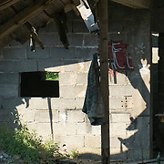 MOSTAR, BOSNIA AND HERZEGOVINA - JUNE 28:  A jacket is seen inside a derelict house damaged during  the 1993 war on June 28, 2013 in Mostar, Bosnia and Herzegovina. The Siege of Mostar reached its peak and more cruent time during 1993. Initially, it involved the Croatian Defence Council (HVO) and the 4th Corps of the ARBiH fighting against the Yugoslav People's Army (JNA) later Croats and Muslim Bosnian began to fight amongst each other, it ended with Bosnia and Herzegovina declaring independence from Yugoslavia.  (Photo by Marco Secchi/Getty Images)