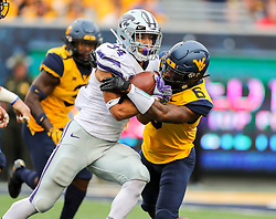 Sep 22, 2018; Morgantown, WV, USA; West Virginia Mountaineers safety Dravon Askew-Henry (6) tackles Kansas State Wildcats running back Alex Barnes (34) during the fourth quarter at Mountaineer Field at Milan Puskar Stadium. Mandatory Credit: Ben Queen-USA TODAY Sports