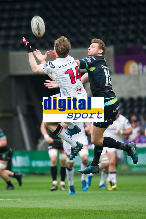 Rugby Union - 2016 / 2017 Guinness Pro12 - Ospreys vs. Ulster<br /> <br /> Andrew Trimble & Dan Biggar of Ospreys leap to take the ball from a kick off, at Liberty Stadium.<br /> <br /> COLORSPORT/WINSTON BYNORTH