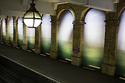 Gloucester Road underground station, London, UK. A large scale photographic mural between the arches of this West London tube station, brings landscape in to the architectural interior.