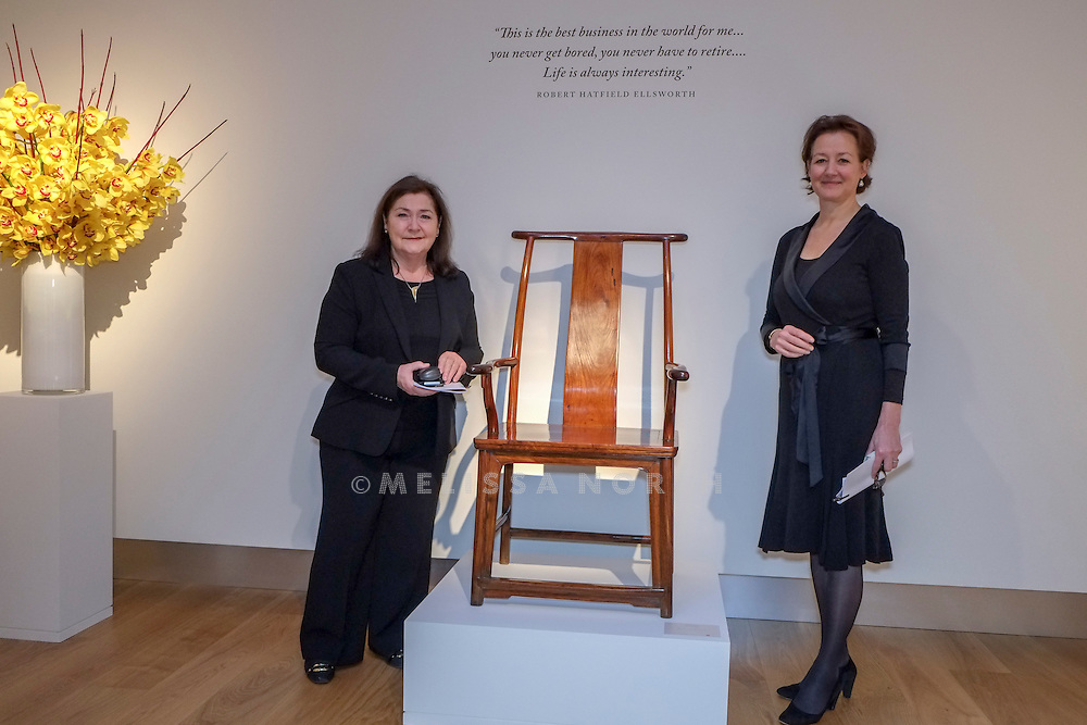 Rosemary E. Scott, International Academic Director and<br /> Leila de Vos van Steenwijk, Director, European Head Chinese Ceramics & Works of Art, stand next to a 'Four-Corners-Exposed' Official's Hat Arm Chair. Part of the touring highlights of The Collection of Robert Hatfield Ellsworth, on display<br /> at Christies in King St, London, UK on Tuesday 16th December 2014. In celebration of this unparalleled collection of Asian Art, Christie's will host a series of auctions and online-only sales during New York Asian Art Week in March 2015. Photo by Melissa North. Ref B5690