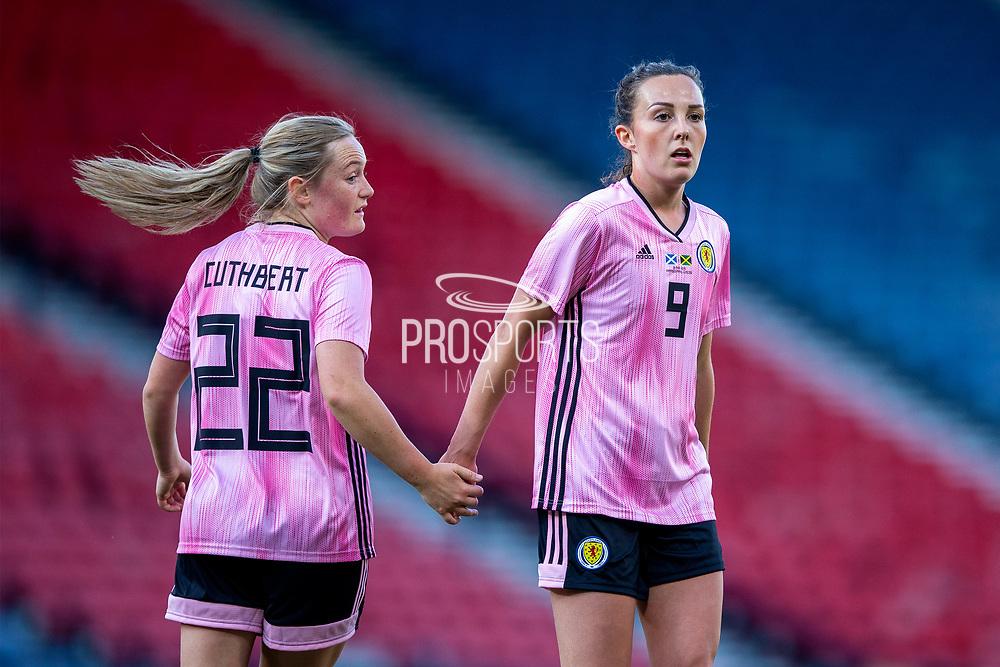 Erin Cuthbert (#22) of Scotland acknowledges an effort on goal from Caroline Weir (#9) of Scotland during the International Friendly match between Scotland Women and Jamaica Women at Hampden Park, Glasgow, United Kingdom on 28 May 2019.