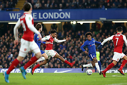 10 January 2018 - Football League Cup - Chelsea v Arsenal - Alex Iwobi of Arsenal takes a poor shot after making an impressive run past Chelsea defenders - Photo: Charlotte Wilson / Offside
