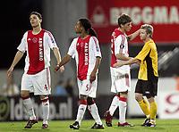 Fotball<br /> UEFA Cup<br /> 14.09.2006<br /> Åråsen Stadion<br /> Start v Ajax Amsterdam<br /> Foto: Morten Olsen, Digitalsport<br /> <br /> L-R: Thomas Vermaelen - Urby Emanuelson - Klaas Jan Huntelaar - Ajax og Fredrik Strømstad - Start