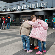 Noon, Tuesday 15th of September 2015.  Aysha hugs her two daughters outside the main entrance of Vienna central station. She was waiting at the queue for hours while I was taking care of the girls. After 2 hours they became nervous and wanted to see their mother, so Aysha found someone to wait for her in the queue and she came out to see the girls.