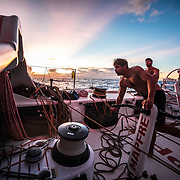Leg 4, Melbourne to Hong Kong, day 11 on board MAPFRE, Guillermo Altadill, Louis Sinclair and Rob Greenhalgh during the sun rise. Photo by Ugo Fonolla/Volvo Ocean Race. 11 January, 2018.