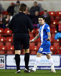 Peterborough United's Lee Tomlin gestures to the match referee - Photo mandatory by-line: Joe Dent/JMP - Tel: Mobile: 07966 386802 11/01/2014 - SPORT - FOOTBALL - County Ground - Swindon - Swindon Town v Peterborough United - Sky Bet League One