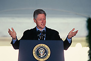 U.S. President Bill Clinton delivers short remarks at the start of the National Medal of Arts awards ceremony on the South Lawn of the White House September 29, 1997 in Washington, DC.