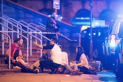 May 22, 2017 - Manchester, England, United Kingdom - Injured concert-goers are helped at the Manchester Arena after reports of an explosion. Manchester police reported 'a number of confirmed fatalities and others injured' as hundreds of fans fled the arena. (Credit Image: © Joel Goodman/London News Pictures via ZUMA Wire)