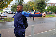AFC Wimbledon defender Kyron Stabana (14) stretching and arriving for the game during the EFL Sky Bet League 1 match between AFC Wimbledon and Lincoln City at the Cherry Red Records Stadium, Kingston, England on 2 November 2019.