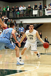 20 February 2016: Kyle Wuest challenges Mark Falotico  during an NCAA men's division 3 CCIW basketball game between the Elmhurst Bluejays and the Illinois Wesleyan Titans in Shirk Center, Bloomington IL