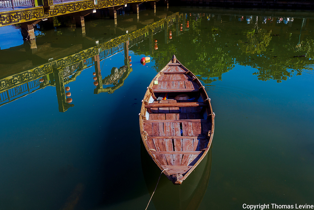 Sept. 2020 Hoi An: Boat floating in front of the bridge in Old Town across the Thu Bon River. RAW to Jpg