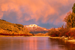 Sunset on the Snake River. A beautiful marriage of cobalt blue and tangerine in the skies of eastern Idaho in Swan Valley along the banks of the South Fork of the Snake River.