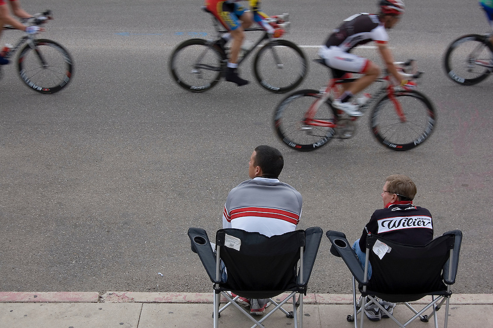 Two spectators watching the bicycle racing action during the 2010 UA Criterium on the University of Arizona's Tucson campus. Bike-togaphy by Martha Retallick.
