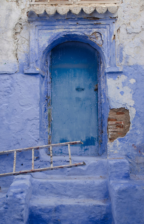 A facade of an old crumbling building in Chefchaouen, Morocco