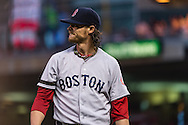 Clay Buchholz #11 of the Boston Red Sox reacts after finishing an inning where he gave up a 2-run home run against the Minnesota Twins on May 17, 2013 at Target Field in Minneapolis, Minnesota.  The Red Sox defeated the Twins 3 to 2.  Photo: Ben Krause