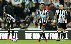 Newcastle United's Rolando Aarons (centre) appears dejected during the Premier League match at St James' Park, Newcastle.