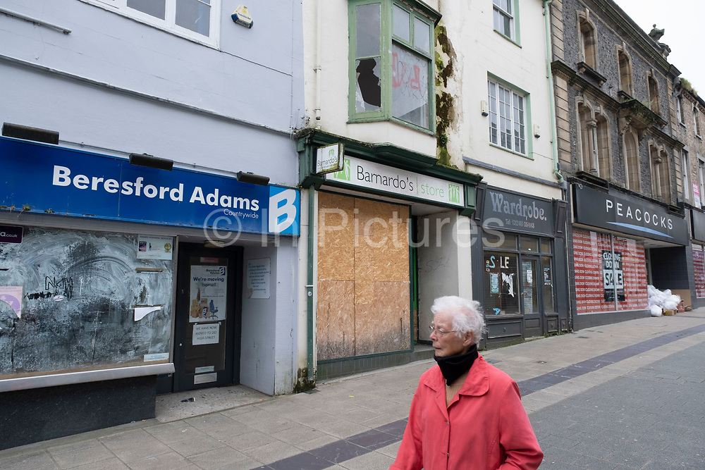 Closed down shops on the High Street due to economic downturn and recession on 16th September 2020 in Bangor, Wales, United Kingdom. Bangor high street has struggled over recent years as more and more shops close, but this is now being compounded by the Coronavirus epidemic as retail becomes more difficult to sustain in low population towns. Bangor is a cathedral city and community in Gwynedd, northwest Wales. It is the oldest city in Wales. Historically part of Caernarfonshire.