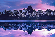 Mount Reka (1991 feet / 607 meters elevation) reflects in Eidsfjord, lit by the midnight sun. Langoy Island, Vesterålen (Vesteraalen), Norway, Europe. Published in Wilderness Travel Catalog of Adventures 1989.