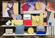 Accessorise shop window display handbags,  Tavern Street, Ipswich, Suffolk, England, UK