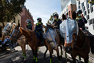 Mounted Police stand by during an Extinction Rebellion protest in Melbourne.  A small group of climate protesters marched from Flagstaff Gardens to The Queen Victoria Market and ending with two individuals gluing themselves together, and then glued themselves to Victoria Avenue outside of the Market. This comes as 5 new COVID-19 cases were uncovered in Melbourne's revamped Hotel Quarantine, breaking almost 40 days of virus free days. (Photo by Dave Hewison/Speed Media)