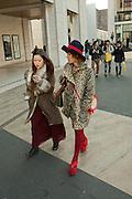 Two women leaving the fashion show.