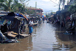 ALBAY, Dec. 26, 2016  A resident wades through the flood brought by Typhoon Nock-Ten in Albay Province, the Philippines, Dec. 26, 2016. Typhoon Nock-Ten is battering provinces south of Manila, leaving at least three people dead, police and local officials said on Monday.  Authorized by ytfs* (Credit Image: © Stringer/Xinhua via ZUMA Wire)