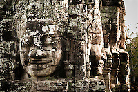 Huge smiling stone faces at The Bayon temple in the walled city of Angkor Thom, Siem Reap, Cambodia