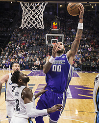 December 31, 2017 - Sacramento, CA, USA - The Sacramento Kings' Willie Cauley-Stein (00) goes to the basket against the Memphis Grizzlies' Tyreke Evans (12) on Sunday, Dec. 31, 2017, at the Golden 1 Center in Sacramento, Calif. (Credit Image: © Hector Amezcua/TNS via ZUMA Wire)
