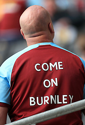 Close up of a Burnley fans shirt saying 'Come On Burnley'