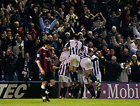 Fotball<br /> England 2004/2005<br /> Foto: SBI/Digitalsport<br /> NORWAY ONLY<br /> <br /> West Bromwich Albion v Manchester City<br /> Barclays Premiership. 22/01/2005'<br /> <br /> West Brom's players celebrate in front of their fans after Ronnie Wallwork's gave them a 2-0 lead to secure the win.