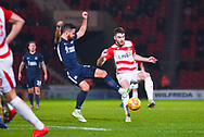 Ben Whiteman of Doncaster Rovers (8) evades Stephen McLaughlin of Southend United (11) during the EFL Sky Bet League 1 match between Doncaster Rovers and Southend United at the Keepmoat Stadium, Doncaster, England on 12 February 2019.