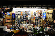 Assorted carvings and souvenirs in market stall. Waikiki, Honolulu, Hawaii