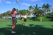 Couple golfing, Hawaii<br />