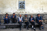 Naxi people of Lijiang dress traditionally in blue, Lijiang, Yunnan.