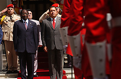 Venezuela President Hugo Chavez and President Robert G. Mugabe of Zimbabwe stand for the Venezuelan national anthem before a bilateral meeting at the Miraflores Presidential Palace in Caracas, Venezuela on Thursday February 26, 2004.  The meeting is part of the G15 summit being held in Caracas.