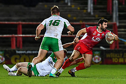 11th November 2018 , Racecourse Ground,  Wrexham, Wales ;  Rugby League World Cup Qualifier,Wales v Ireland ; Rhys Williams of Wales evades the tackle of Lewis Bienek of Ireland <br /> <br /> <br /> Credit:   Craig Thomas/Replay Images