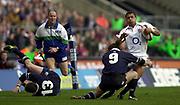 Twickenham, Surrey, 22nd March 2003,  RFU Twickenham Stadium, England, [Mandatory Credit; Peter Spurrier/Intersport Images]<br /> <br /> RBS Six Nations  Rugby England v Scotland<br /> Jason Robinson is tackled by club mate Bryan Redpath.
