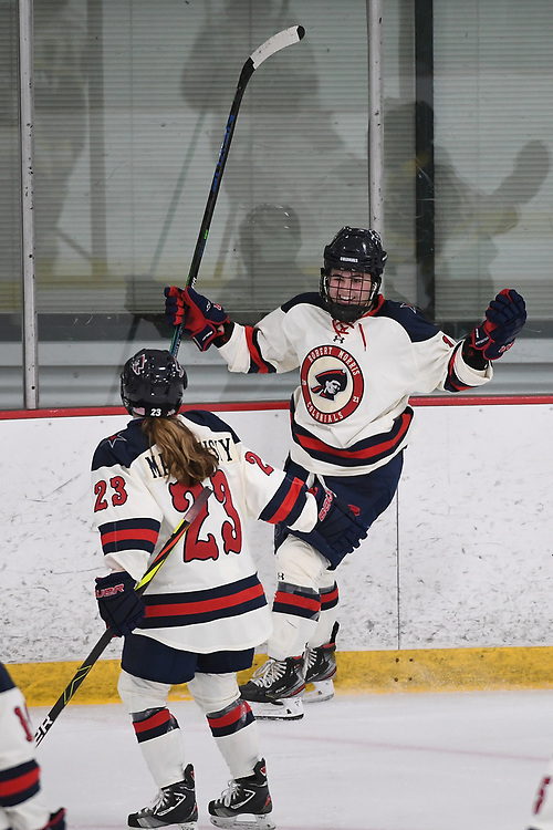 PITTSBURGH, PA - JANUARY 04: Michaela Boyle #16 of Robert Morris Colonials celebrates with Ellie Marcovsky #23 after scoring a goal in the second period during the game against the Adrian Bulldogs at Clearview Arena on January 4, 2021 in Pittsburgh, Pennsylvania. (Photo by Justin Berl/Robert Morris Athletics)
