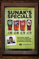 """© Licensed to London News Pictures. 10/10/2020. Manchester, UK. Sign advertising """" Sunak's Specials """" at a branch of Wetherspoon pub . People out in pubs, bars and restaurants in Manchester City Centre ahead of the currently imposed daily 10pm curfew . Millions of people across the north of England are waiting to learn if the British Government will impose a regional lockdown on Monday (12th October 2020), as Coronovirus infection rates continue to rise rapidly . Photo credit: Joel Goodman/LNP"""