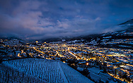 La ville de Sion de nuit sour la neige en hiver le 18 décembre 2017<br /> <br /> La suisse romande est candidate pour l'organisation des Jeux olympiques d'hiver 2026 sous l'egide de Sion 2026. La population valaisanne votera sur les JO le 10 juin <br /> Sion is a candidate for the organization of the Olympic Winter Games 2026 under the aegis of Sion 2026.<br /> <br /> (PHOTO-GENIC.CH/ OLIVIER MAIRE)