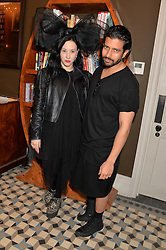 Left to right, actress ROSE LESLIE and ALEX ALLASON at a preview party for a new private members club 'Library' 112 St Martin's Lane, London on 16th April 2014.