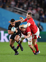 Rugby Union - 2019 Rugby World Cup - Bronze Final (Third Place Play-Off): New Zealand vs. Wales<br /> <br /> New Zealand's Richie Mo'unga evades the tackle of Wales' James Davies and Dan Biggar, at Tokyo Stadium, Tokyo.<br /> <br /> COLORSPORT/ASHLEY WESTERN